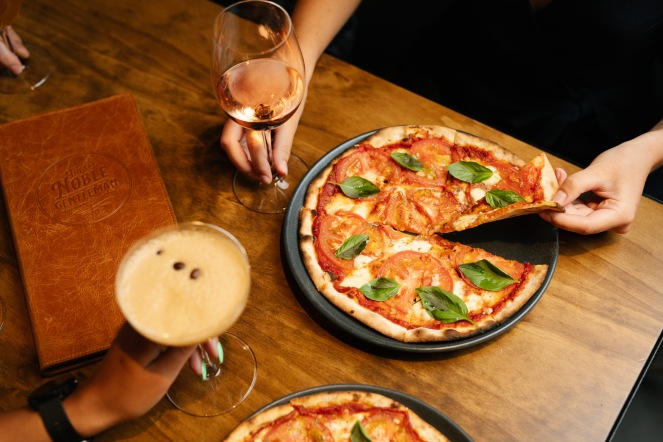 Pizza with espresso martini and wine